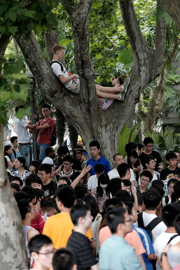 SHANGHAI, CHINA - JUNE 20:  Fans wait outside the cordon during David Beckham's visit to Tongji University on June 20, 2013 in Shanghai, China.  (Photo by Lintao Zhang/Getty Images) Photo: Lintao Zhang, Getty Images
