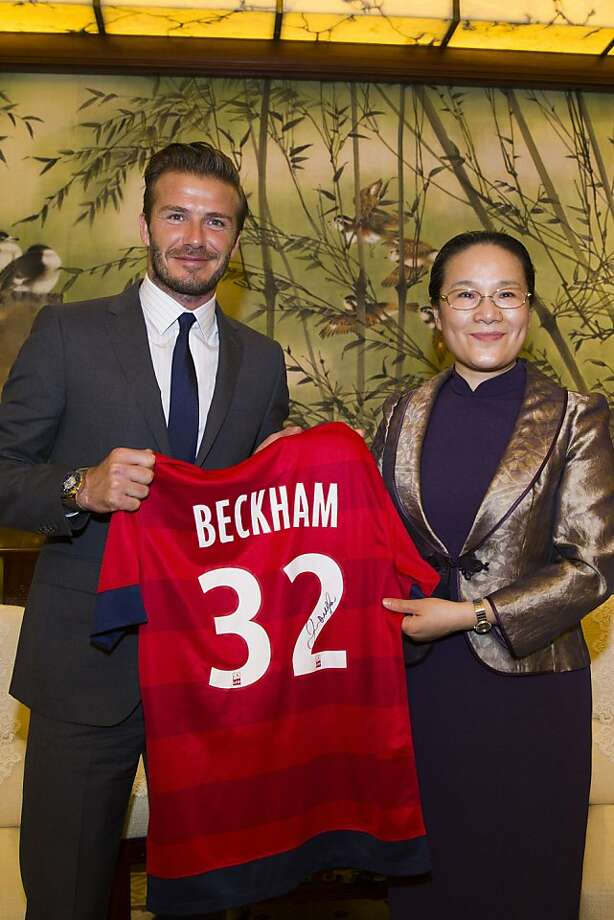 SHANGHAI, CHINA - JUNE 20:  (CHINA OUT) David Beckham meets with Shanghai Vice Mayor Zhao Wen (R) at the government building on June 20, 2013 in Shanghai, China.  (Photo by ChinaFotoPress/Getty Images) Photo: ChinaFotoPress, Getty Images