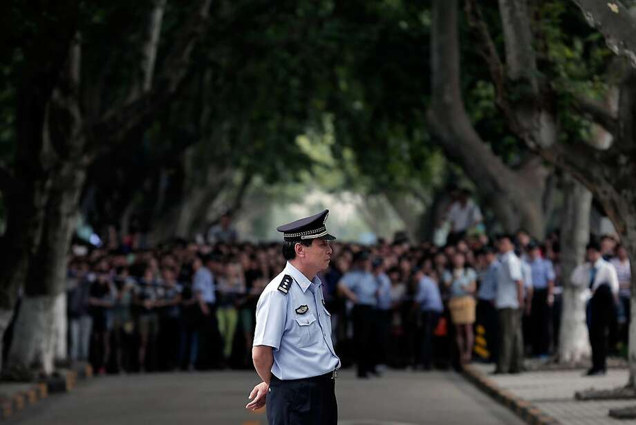 SHANGHAI, CHINA - JUNE 20:  A policeman on duty during David Beckham's visit at Tongji University on June 20, 2013 in Shanghai, China.  (Photo by Lintao Zhang/Getty Images) Photo: Lintao Zhang, Getty Images