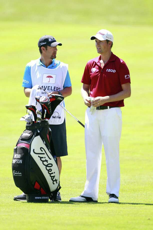 CROMWELL, CT - JUNE 20: Webb Simpson (R) stands by his golf bag during the first round of the Travelers Championship held at TPC River Highlands on June 20, 2013 in Cromwell, Connecticut. Photo: Michael Cohen, Getty Images / 2013 Getty Images