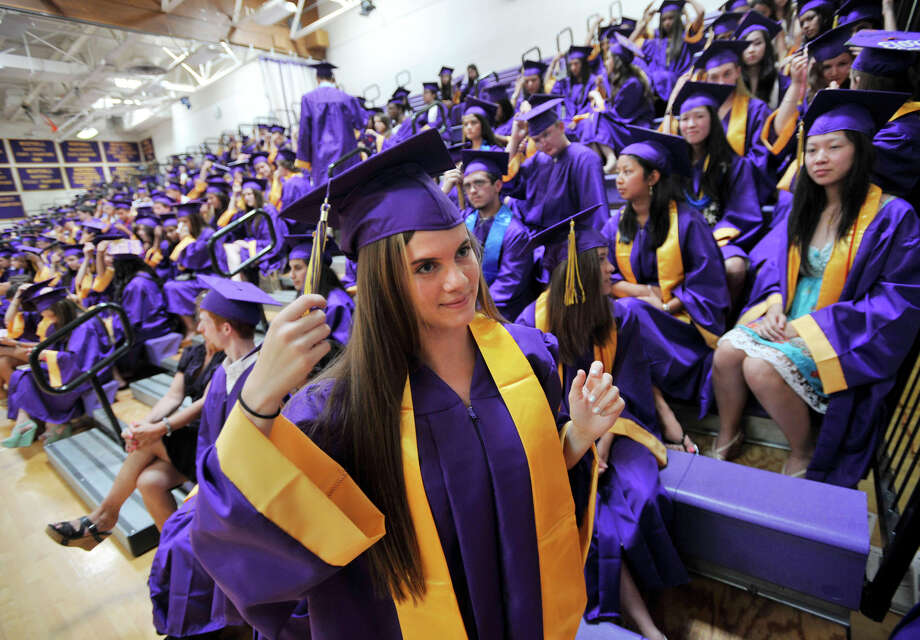 Laura Schaffer readies her cap and gown before the Westhill High School graduation ceremony in Stamford on Thursday, June 20, 2013. Photo: Jason Rearick / Stamford Advocate