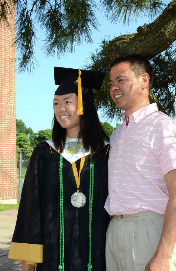 Graduate Tatiana Eng poses for a photo with her father Simon Eng during the 2013 commencement excercises at Jonathan Law High School in Milford on Thursday, June 20, 2013. Photo: Amy Mortensen / Connecticut Post Freelance