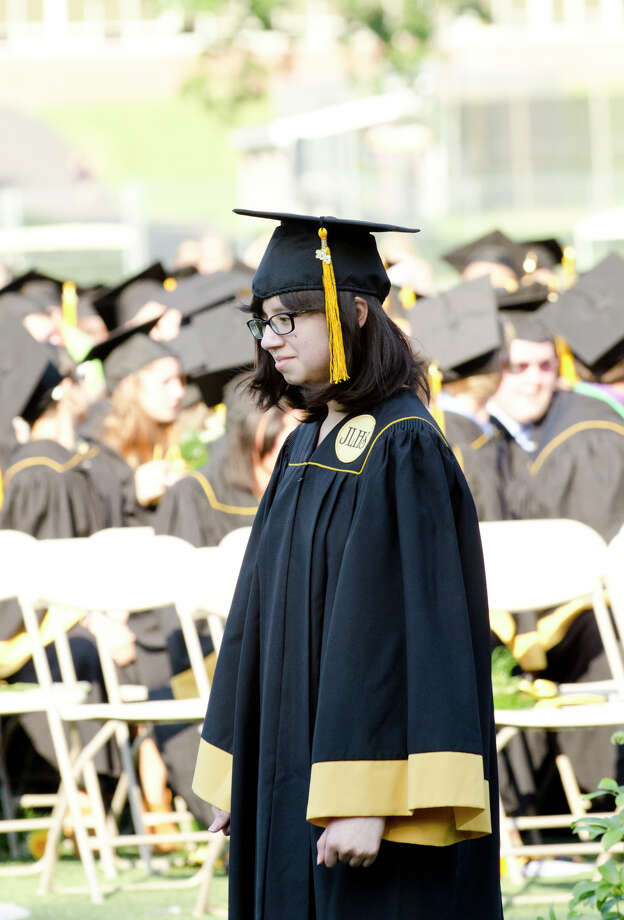 Graduate Marina Espinoza waits for her name to be called during the 2013 commencement excercises at Jonathan Law High School in Milford on Thursday, June 20, 2013. Photo: Amy Mortensen / Connecticut Post Freelance