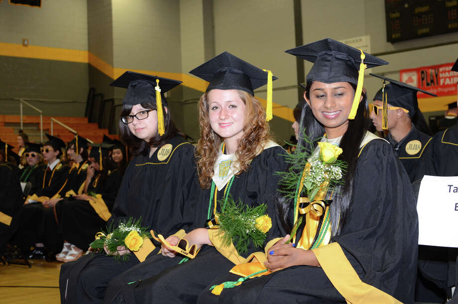 Graduates from left to right, Marina Espinoza, Valerie Hiller and Bhavani Jaladanki, wait in the staging area during the 2013 commencement excercises at Jonathan Law High School in Milford on Thursday, June 20, 2013. Photo: Amy Mortensen / Connecticut Post Freelance