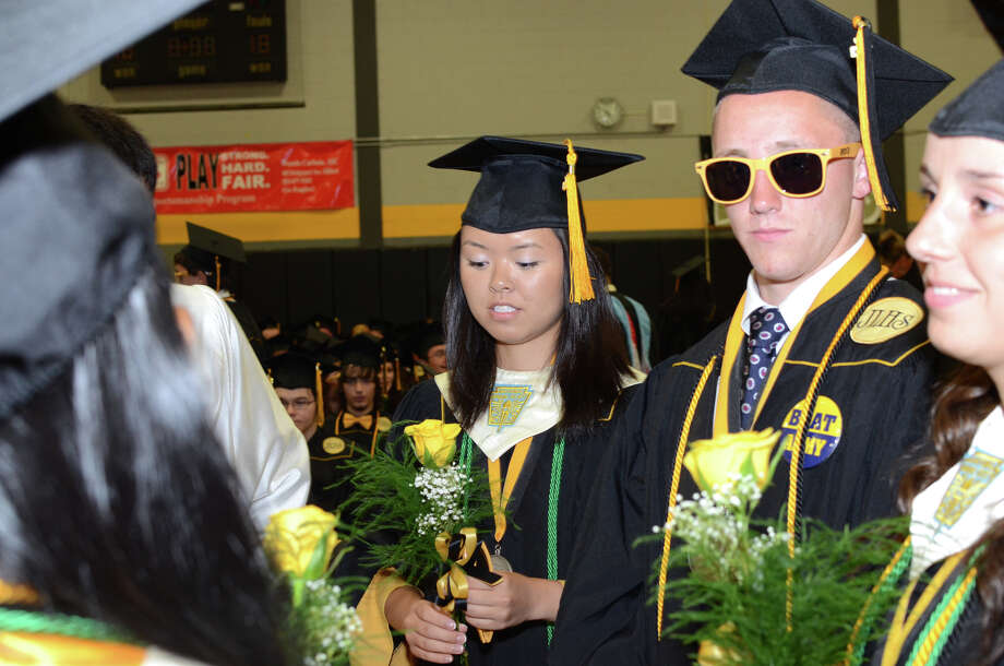 Graduate Tatiana Eng, center, looks down at her rose in the staging area during the 2013 commencement excercises at Jonathan Law High School in Milford on Thursday, June 20, 2013. Photo: Amy Mortensen / Connecticut Post Freelance