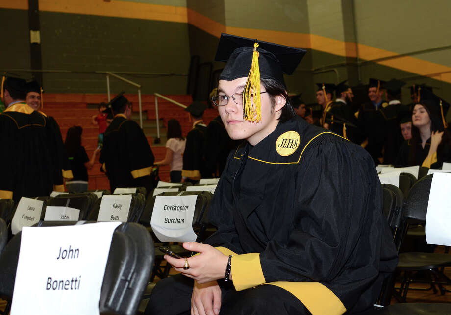 Kyle Broderick sits in the graduate staging area during the 2013 commencement excercises at Jonathan Law High School in Milford on Thursday, June 20, 2013. Photo: Amy Mortensen / Connecticut Post Freelance