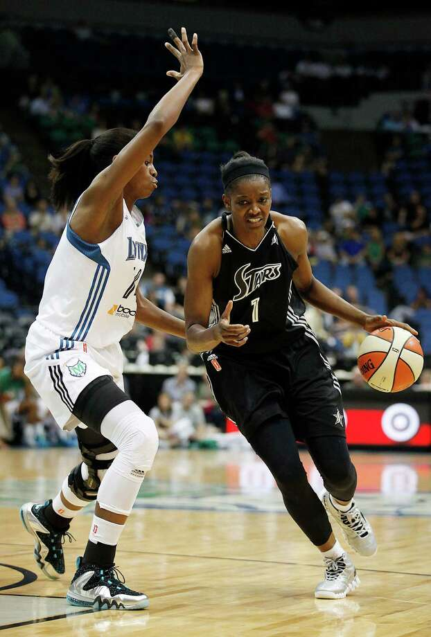 San Antonio Silver Stars forward DeLisha Milton-Jones (1) dribbles the ball by Minnesota Lynx forward Devereaux Peters (14) in the second half of a WNBA basketball game, Tuesday, June 11, 2013, in Minneapolis. The Lynx won 87-72.(AP Photo/Stacy Bengs) Photo: Stacy Bengs, Associated Press / FR170489 AP