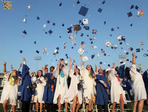 Fairfield Ludlowe High School graduates celebrate after commencement exercises at the Connecticut school on Thursday, June 20, 2013. Photo: BK Angeletti, B.K. Angeletti / Connecticut Post freelance B.K. Angeletti