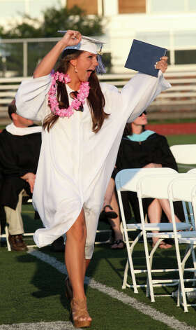 Fairfield Ludlowe High School graduate Colleen Keith reacts after receiving her diploma during commencement exercises at the Connecticut school on Thursday, June 20, 2013. Photo: BK Angeletti, B.K. Angeletti / Connecticut Post freelance B.K. Angeletti