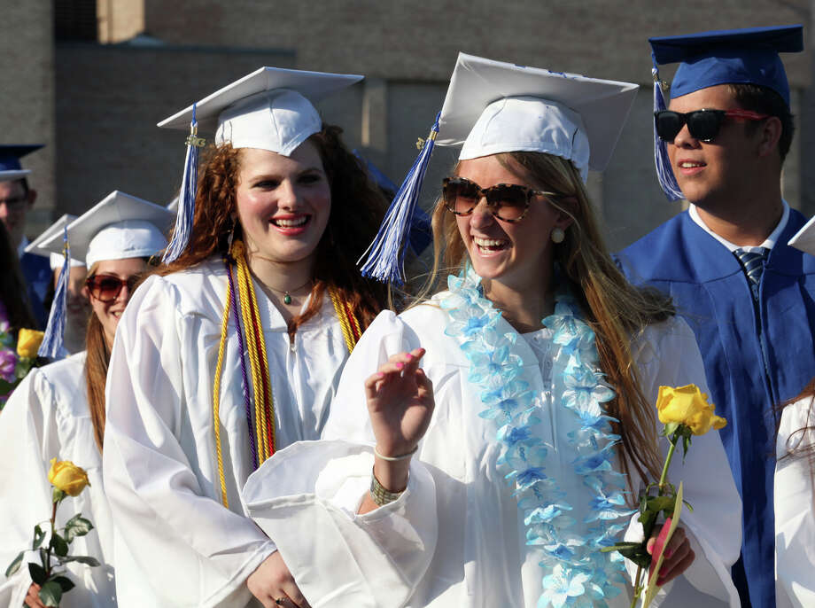 Fairfield Ludlowe High School graduate Glenn Carr reacts to the crowd during commencement exercises at the Connecticut school on Thursday, June 20, 2013. Photo: BK Angeletti, B.K. Angeletti / Connecticut Post freelance B.K. Angeletti