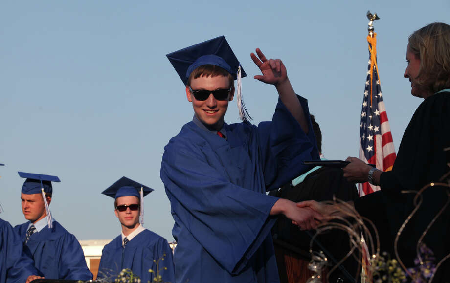 Fairfield Ludlowe High School graduate Noah Freed reacts before receiving his diploma during commencement exercises at the Connecticut school on Thursday, June 20, 2013. Photo: BK Angeletti, B.K. Angeletti / Connecticut Post freelance B.K. Angeletti