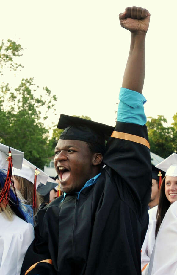 Winston Sinclair pumps his fist at the end of the Stamford High School graduation ceremony on Thursday, June 20, 2013. Photo: Jason Rearick / Stamford Advocate