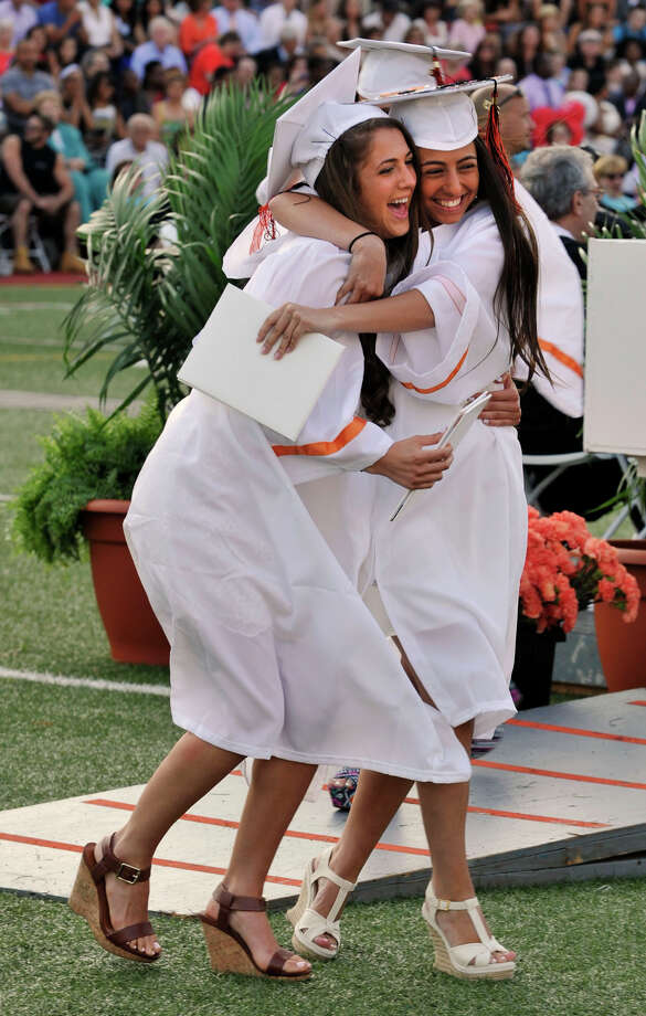 Samantha Schneider, left, and Flutura Isufaj embrace after receivingtheir diplomas during the Stamford High School graduation ceremony on Thursday, June 20, 2013. Photo: Jason Rearick / Stamford Advocate