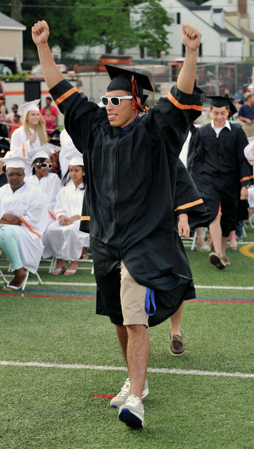 Miguel Nieto walks to the stage to accept his diploma during the Stamford High School graduation on Thursday, June 20, 2013. Photo: Jason Rearick / Stamford Advocate