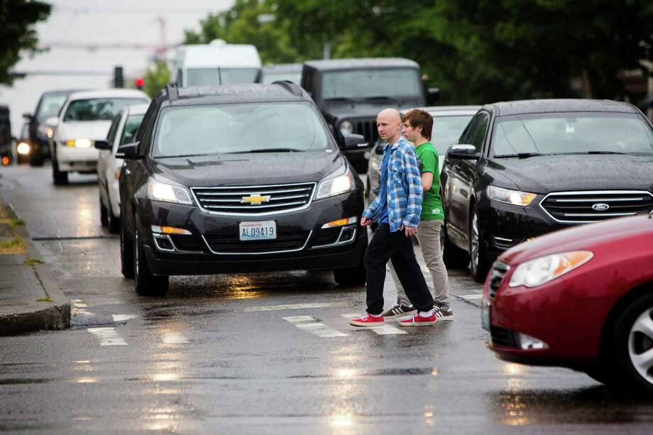A seattlepi.com analysis of state Department of Transportation collision records shows which Seattle intersections have seen the most car-on-pedestrian crashes in the past three years. Click through to see which intersections saw the most reported crashes involving walkers between January 2010 and January 2013. Above, pedestrians navigate the intersection of 15th Avenue Northwest and Northwest Market Street Thursday, June 20, 2013, in the Ballard neighborhood of Seattle. Photo: JORDAN STEAD, SEATTLEPI.COM / SEATTLEPI.COM