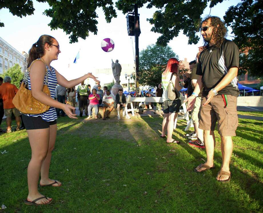 Paloma Corrigan, left, and Oscar Leiva, right, play with a beach ball during Alive@Five in downtown Stamford, Conn., on Thursday, June 20, 2013. Photo: Lindsay Perry / Stamford Advocate