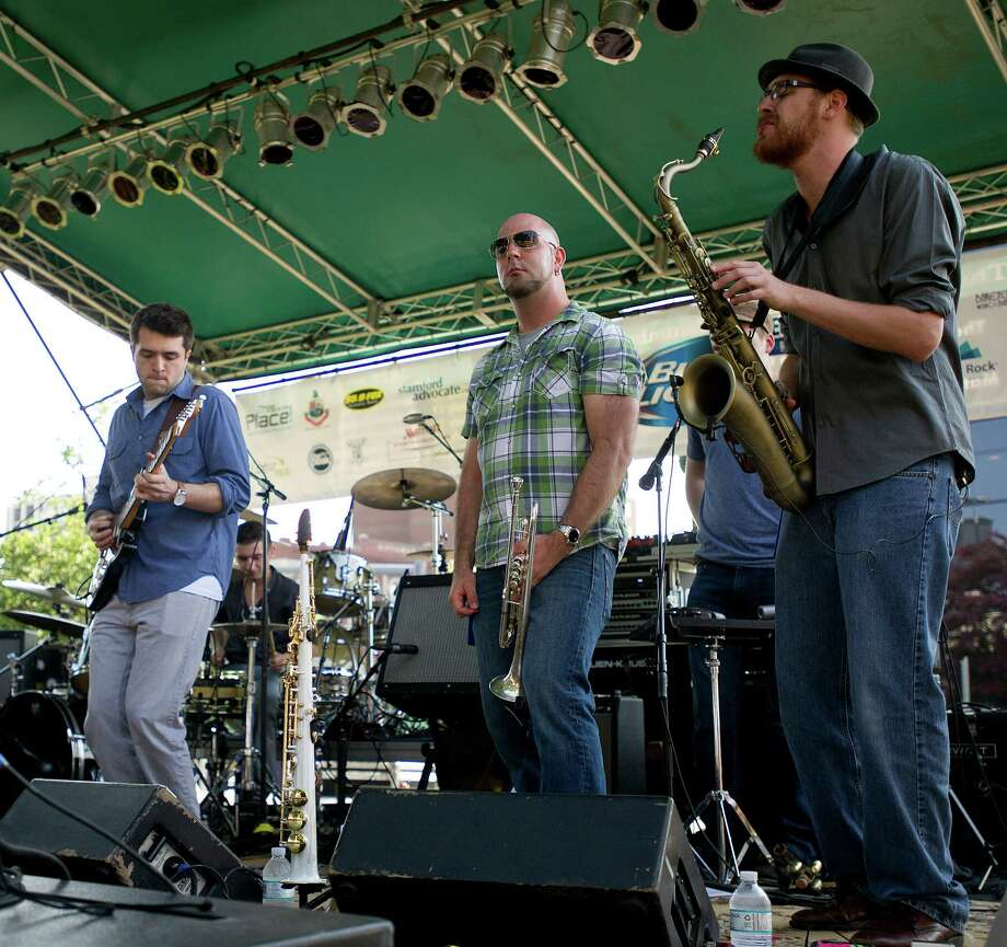 The Como Brothers Band performs during Alive@Five in downtown Stamford, Conn., on Thursday, June 20, 2013. Photo: Lindsay Perry / Stamford Advocate