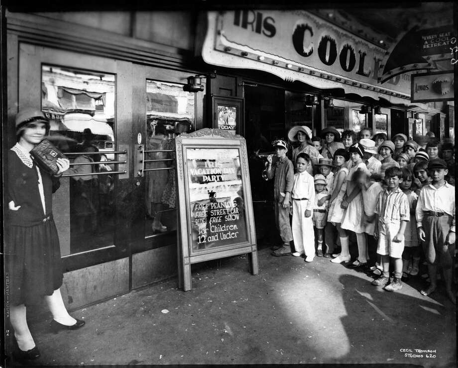 Dressed for the weather, young Houstonians gather at downtown's air-conditioned Iris Theater for a summer Vacation Day Party. The Iris (1919-1965) was on Travis Street at the present site of the JPMorgan Chase Tower. Photo: San Jacinto Museum Of History Association