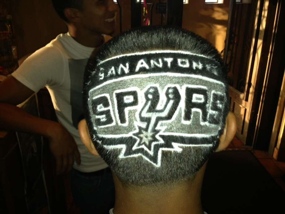 Vincent Gutierrez,16, got a trim for the special occasion. The piece, done by local barber and artist Rob Ferrel, took over one hour to complete. Photo: Sam M. Peshek / San Antonio Express-News