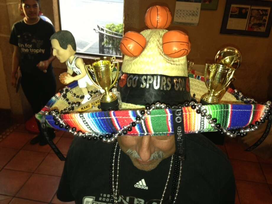 Alfredo Gutierrez, 61, says he is ready to put trophy number 5 on top of his Spurs sombrero. The hat has seen championships in 2003 and 2007. Photo: Sam M. Peshek / San Antonio Express-News