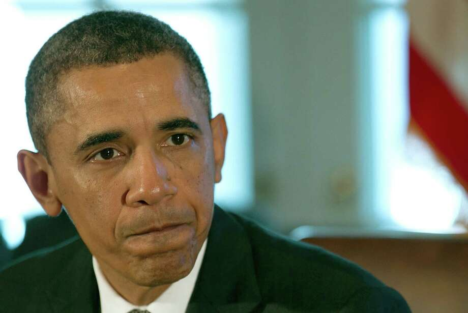 President Barack Obama has issued a veto threat against the House GOP's spending measures, which would transfer $28 billion from domestic programs to patch up the Pentagon's budget. Photo: Getty Images File Photo
