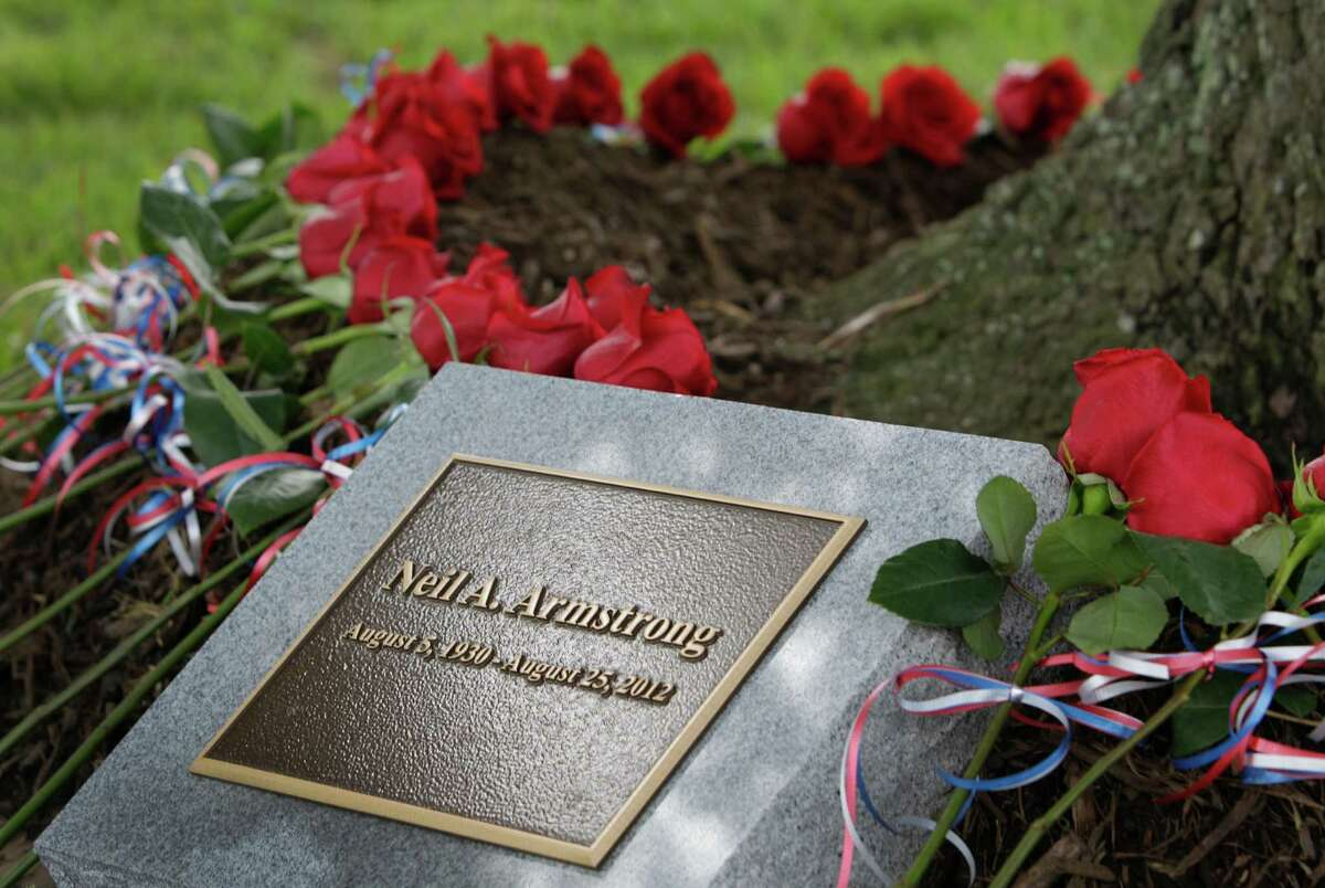 Roses were placed around tree by family and guests during a tree dedication service for Neil Armstrong in the Astronaut Memorial Grove at NASA Johnson Space Center Thursday, June 20, 2013, in Houston. NASA also held a memorial service prior to the tree dedication service. Armstrong made history on July 20, 1969, when he became the first person to walk on the moon as commander of Apollo 11.