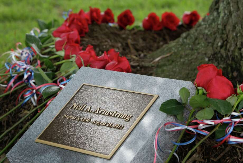 Roses were placed around tree by family and guests during a tree dedication service for Neil Armstrong in the Astronaut Memorial Grove at NASA Johnson Space Center Thursday, June 20, 2013, in Houston.  NASA also held a memorial service prior to the tree dedication service. Armstrong made history on July 20, 1969, when he became the first person to walk on the moon as commander of Apollo 11. Photo: Melissa Phillip, Houston Chronicle / © 2013  Houston Chronicle