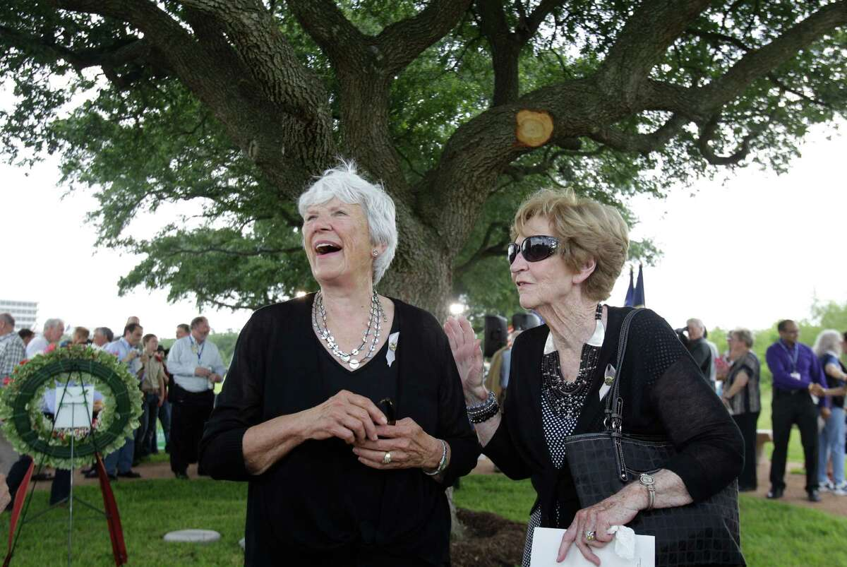 Janet Armstrong, left, the widow of Neal Armstrong, visits with Marilyn See, right, the widow of astronaut Elliot See, after a tree dedication service for Neil Armstrong in the Astronaut Memorial Grove at NASA Johnson Space Center Thursday, June 20, 2013, in Houston. The woman said they have not seen each other in more than 30 years.