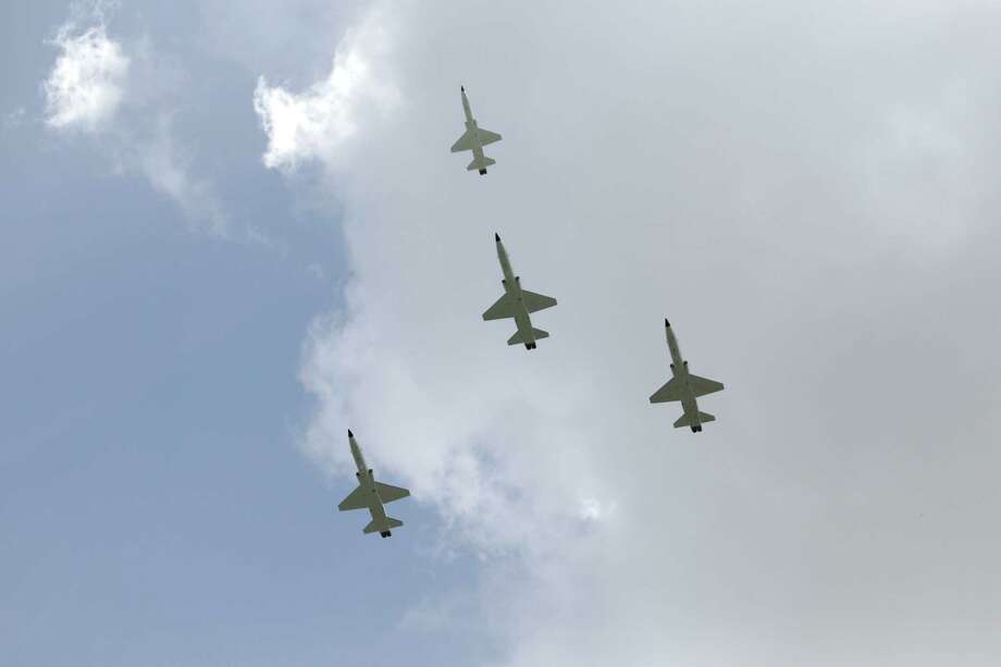 A missing man formation is performed during a T-38 flyover at a tree dedication service for Neil Armstrong in the Astronaut Memorial Grove at NASA Johnson Space Center Thursday, June 20, 2013, in Houston. Photo: Melissa Phillip, Houston Chronicle / © 2013  Houston Chronicle