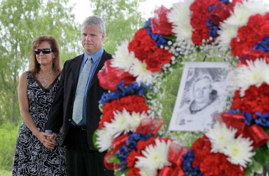 Wendy Armstrong, left, and her husband, Mark Armstrong, son of Neil Armstrong, watch during tree dedication service for Neil Armstrong in the Astronaut Memorial Grove at NASA Johnson Space Center Thursday, June 20, 2013, in Houston. Photo: Melissa Phillip, Houston Chronicle / © 2013  Houston Chronicle