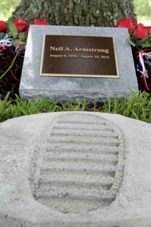 A cast made from a 3-D model of Neil Armstrong's moon foot print is displayed at a tree dedication service for Neil Armstrong in the Astronaut Memorial Grove at NASA Johnson Space Center Thursday, June 20, 2013, in Houston.  Members of Boy Scout Troop 1598 made the cast. Photo: Melissa Phillip, Houston Chronicle / © 2013  Houston Chronicle