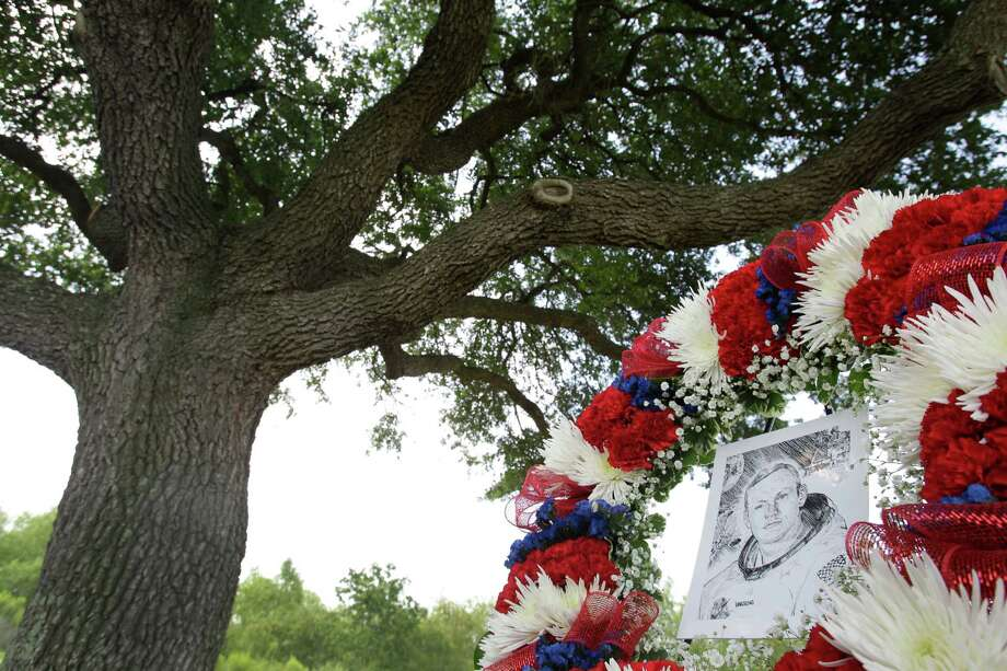 A wreath is displayed for a tree dedication service for Neil Armstrong in the Astronaut Memorial Grove at NASA Johnson Space Center Thursday, June 20, 2013, in Houston. Photo: Melissa Phillip, Houston Chronicle / © 2013  Houston Chronicle