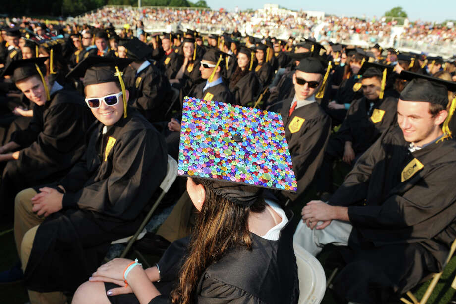 Emma Boniche wear a brightly colored cap as she and her fellwow graduates attend Commencement Exercises for the Trumbull High School Class of 2013, in Trumbull, Conn., June 20th, 2013. Photo: Ned Gerard / Connecticut Post