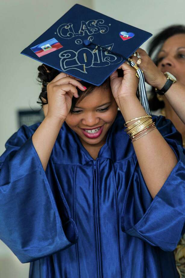 Chantale Marie Nelson gets some help putting her cap on from Janis Curtis prior to the start of the Briggs high school graduation held at Brien McMahon high school, Norwalk, CT on Thursday June 20th, 2013. Photo: Mark Conrad / Stamford Advocate Freelance