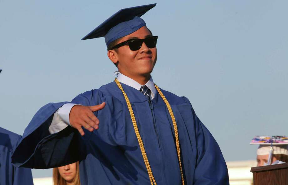 Fairfield Ludlowe High School graduate Michael Wise Tang reacts before receiving his diploma during commencement exercises at the Connecticut school on Thursday, June 20, 2013. Photo: BK Angeletti, B.K. Angeletti / Connecticut Post freelance B.K. Angeletti