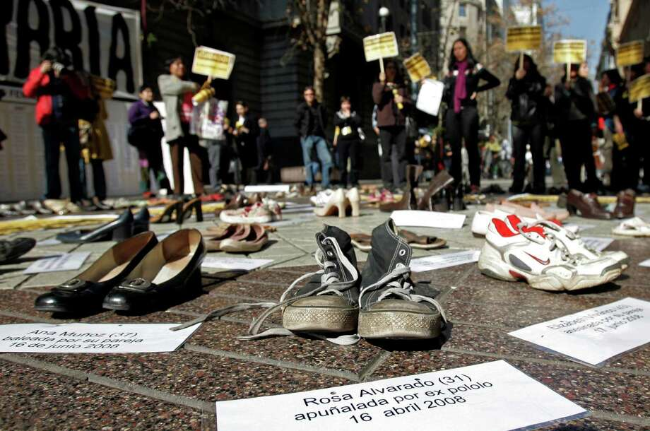Shoes representing female victims of violence are displayed by protesters from the Chilean Network Against Domestic and Sexual Violence in Santiago in 2009. Photo: Associated Press File Photos