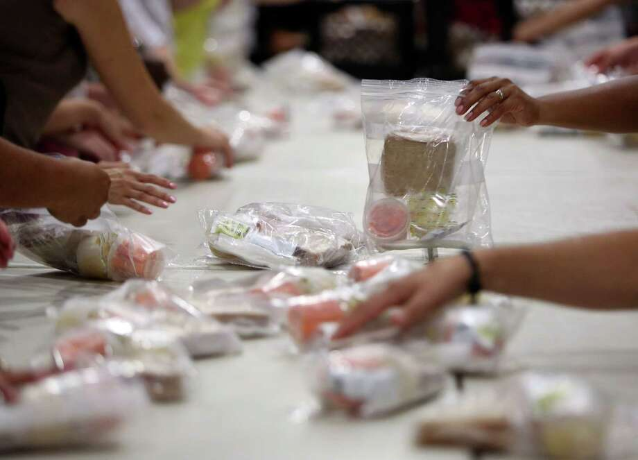 Children and teenagers under age 18 can receive meals on weekdays at locations across Midland. Photo: San Antonio Express-News / ©2013 San Antonio Express-News