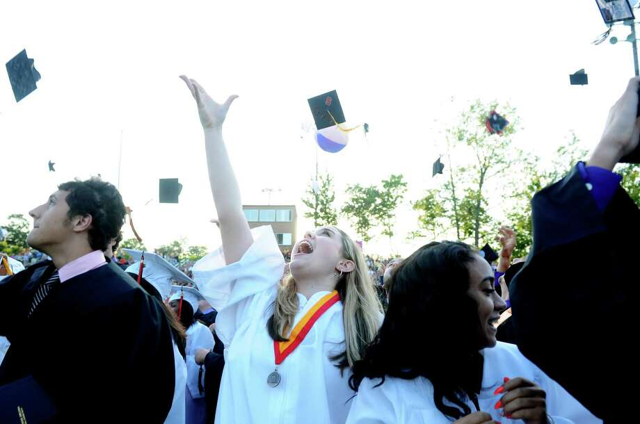 Graduate Christina Buonanno tosses her cap into the air during Shelton High School's commencement ceremony Thursday, June 20, 2013 at the school. Photo: Autumn Driscoll / Connecticut Post