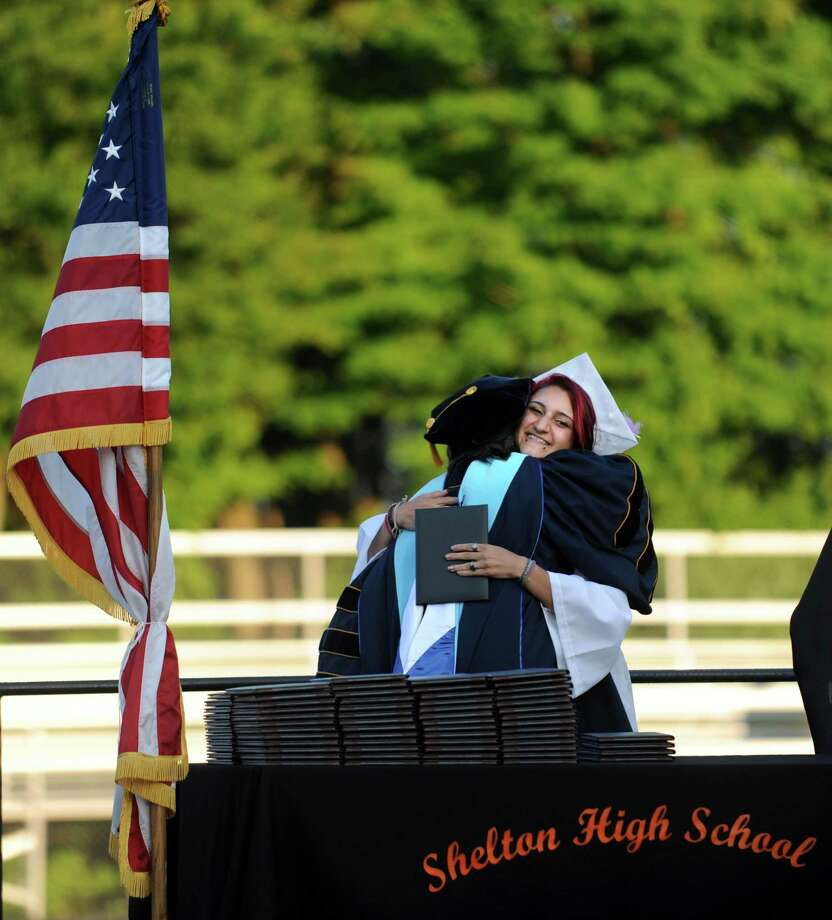 Graduate Tatiana Rivera hugs Headmaster Beth A. Smith during Shelton High School's commencement ceremony Thursday, June 20, 2013 at the school. Photo: Autumn Driscoll / Connecticut Post