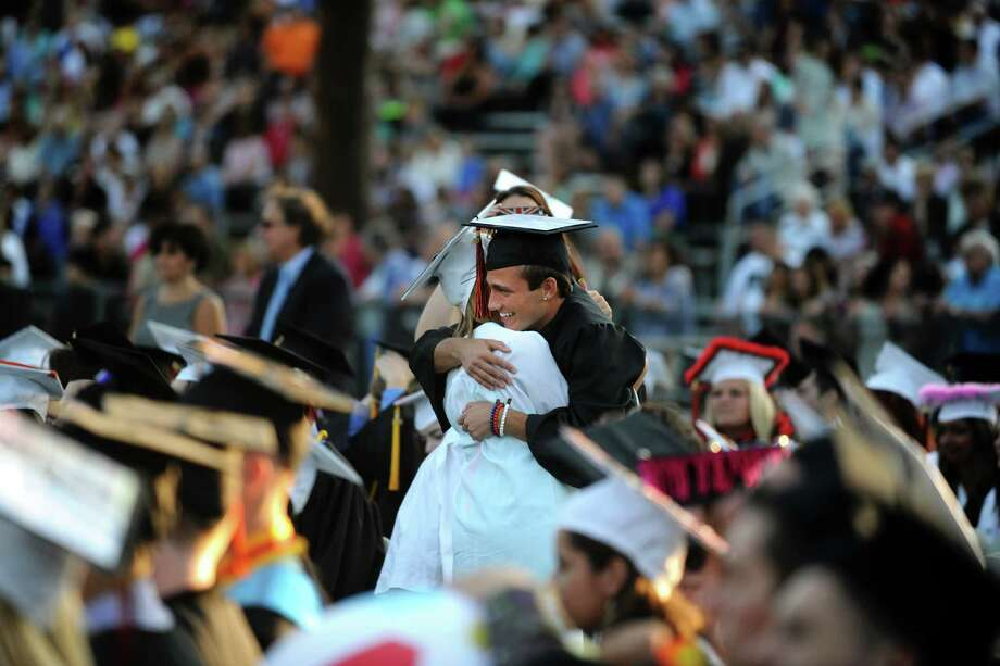 Graduates Nicholas Markus and Ashley Kingersky embrace after receiving diplomas during Shelton High School's commencement ceremony Thursday, June 20, 2013 at the school. Photo: Autumn Driscoll / Connecticut Post