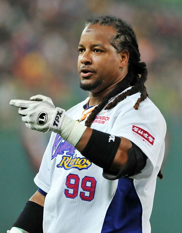This photo taken on March 27, 2013 shows former Boston Red Sox slugger Manny Ramirez gesturing during his debut game on the island after joining EDA Rhinos in March, in Taiwan's southern Kaohsiung baseball stadium. US baseball legend Manny Ramirez quit Taiwan's EDA Rhinos on June 19, breaking local fans' hearts just three-months after joining the team despite being the highest paid player in the league's history.  AFP PHOTO / Mandy ChengMandy Cheng/AFP/Getty Images Photo: Mandy Cheng, AFP/Getty Images