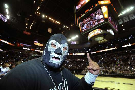 Spurs fan Arturo Alderete cheers before watching the NBA Finals Game 7 between the Spurs and the Miami Heat in Miami on big screen during a viewing party at the AT&T Center, the  Spurs home court, on Thursday night, June 20, 2013. Th Photo: Billy Calzada, San Antonio Express-News / San Antonio Express-News