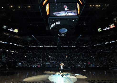 The Spurs Coyote mascot leads cheers as fans light flashlights as they watch the NBA Finals Game 7 between the Spurs and the Miami Heat in Miami on big screen during a viewing party at the AT&T Center, the  Spurs home court, on Thursday night, June 20, 2013. Th Photo: Billy Calzada, San Antonio Express-News / San Antonio Express-News