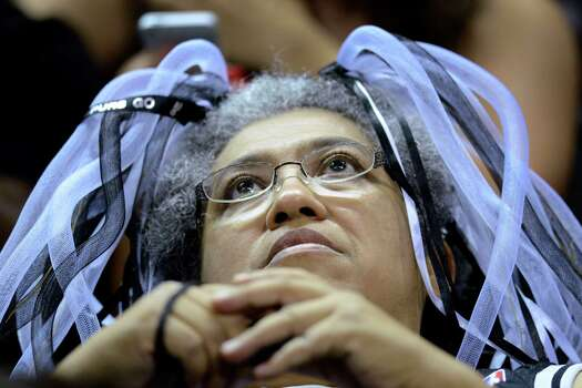 Spurs fans Frances Clark watches the NBA Finals Game 7 between the Spurs and the Miami Heat in Miami on big screen during a viewing party at the AT&T Center, the  Spurs home court, on Thursday night, June 20, 2013. Photo: Billy Calzada, San Antonio Express-News / San Antonio Express-News
