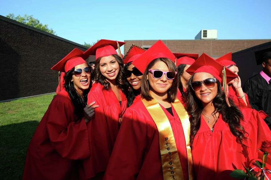 Mike Ross Connecticut Post freelance -Platt Tech graduates (from left to right) Courtney Milano, Ashley Natale, Tabytha Longway, Taylor Mason and Jessica Mesa pose for a group photo at stagging area for Thursday afternoon's commencement exercises. Photo: Mike Ross / Mike Ross Connecticut Post freelance -www.mikerossphoto.com