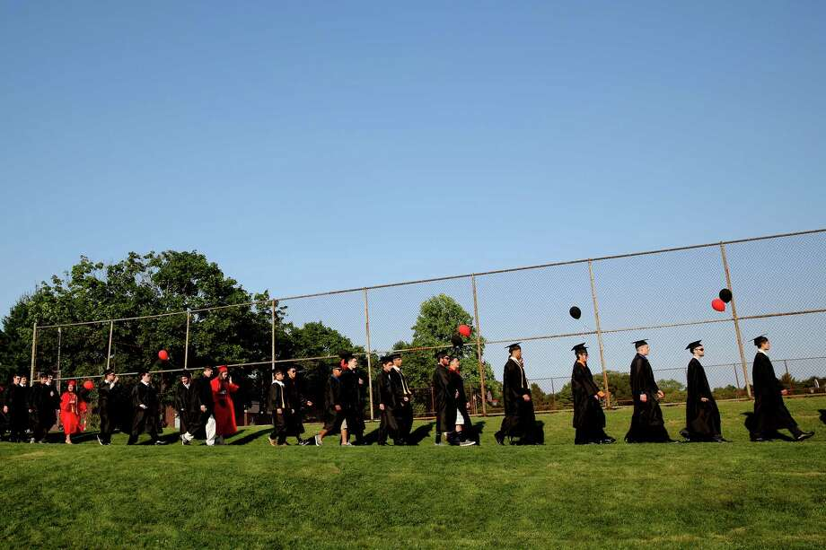 Mike Ross Connecticut Post freelance -Platt Tech graduates make their way for processional for Thursday afternoon's commencement exercises. Photo: Mike Ross / Mike Ross Connecticut Post freelance -www.mikerossphoto.com