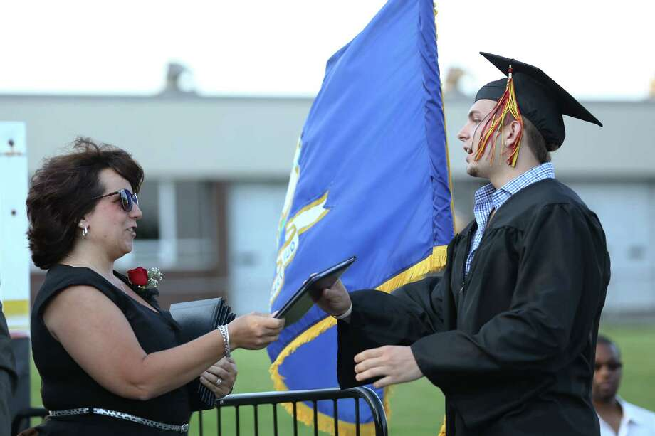 Mike Ross Connecticut Post freelance -Platt Tech graduate Chris Gargiulo accepts his diploma during Thursday afternoon's commencement exercises. Gargiulo will attend Gateway in New Haven in the fall. Photo: Mike Ross / Mike Ross Connecticut Post freelance -www.mikerossphoto.com