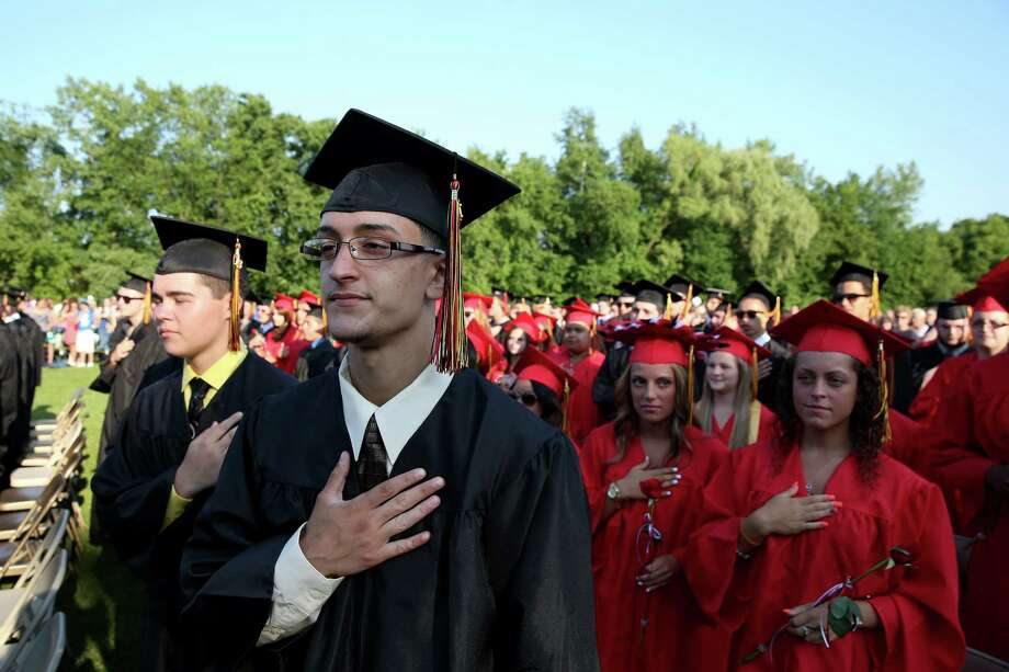 Mike Ross Connecticut Post freelance -Platt Tech graduate Xavier Rodriguez of New Haven stands at attenion during the pledge of Allegiance during Thursday afternoon's commencement exercises. Photo: Mike Ross / Mike Ross Connecticut Post freelance -www.mikerossphoto.com