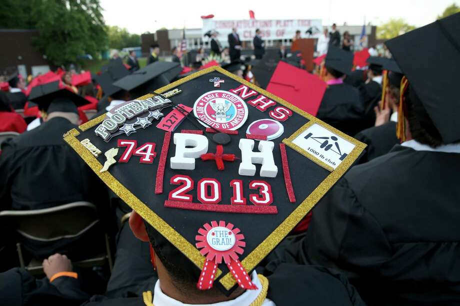 Mike Ross Connecticut Post freelance -A Platt Tech gradudate sporting a decorate cap during Thursday afternoon commencement exercises. Photo: Mike Ross / Mike Ross Connecticut Post freelance -www.mikerossphoto.com