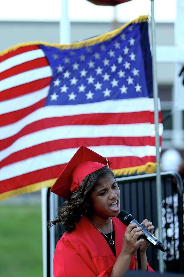 "Mike Ross Connecticut Post freelance -Platt Tech graduate Mariah Honafius sings ""No Boundaries"" duirng Thursday afternoon's commencement exercises. Photo: Mike Ross / Mike Ross Connecticut Post freelance -www.mikerossphoto.com"
